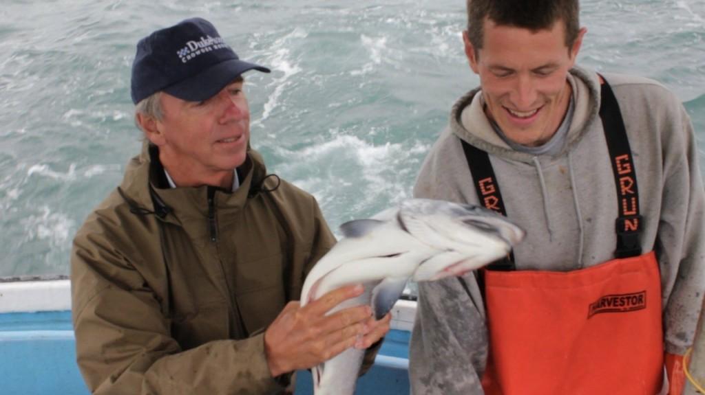 Duke Holding Fish with Jimi