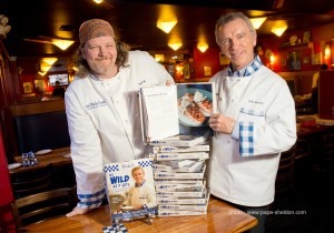 Duke Showing His New Cookbook