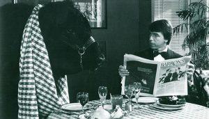 Duke sitting with bull in restaurant