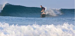 Amy Waeschle surfing a right-breaking wave near Troncones, Mexico.