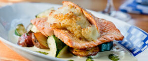 Duke's Seafood Stuffed Salmon over Grilled Vegetables